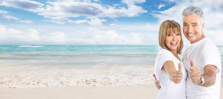 Happy senior couple on the beach Stock Photo - 17414992