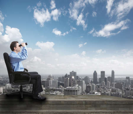 Businessman with binoculars  Stock Photo - 17573235