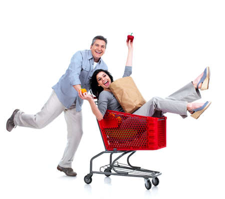 Happy couple with a grocery shopping cart  photo
