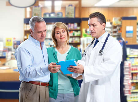 Pharmacist with a senior couple  Stock Photo - 17658040