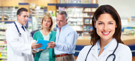 Pharmacist with a senior couple  Stock Photo - 17658025