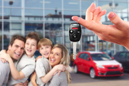 rent car: Happy family with a new car keys