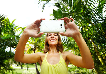 palm garden: Woman with a smartphone  Stock Photo