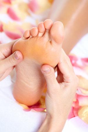 reflexology: Feet massage  Stock Photo