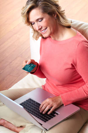 Woman with laptop and a credit card  photo