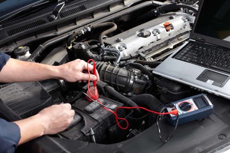 diagnostic tool: Car mechanic working in auto repair service