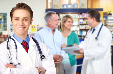 Pharmacist with a senior couple  photo