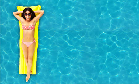 Woman relaxing in pool  photo
