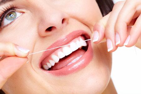 flossing: Beautiful woman smile
