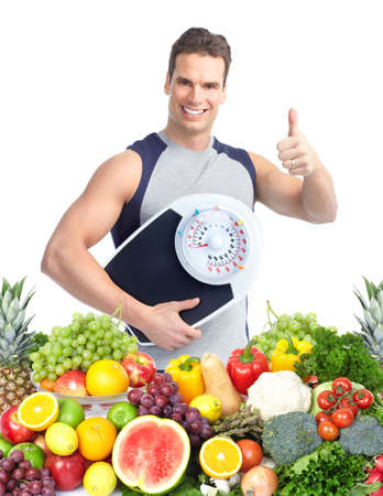 sante: Happy man with scales  Stock Photo
