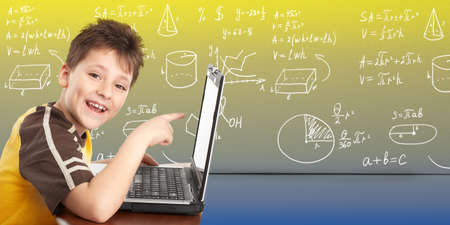 Young boy with laptop computer  photo