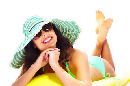 Woman relaxing on the beach Stock Photo - 18358045