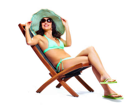Woman relaxing on the beach Stock Photo - 18388129