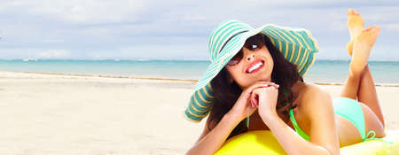 Woman relaxing on the beach Reklamní fotografie - 18452127