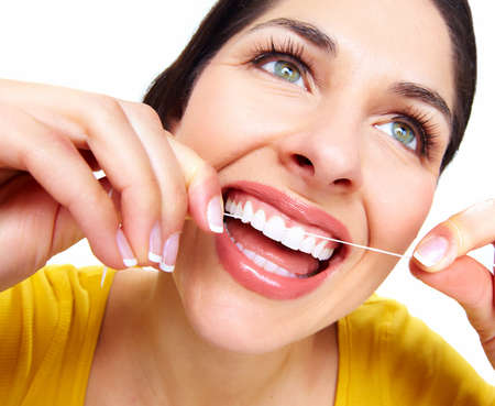 floss: Beautiful woman with a dental floss  Stock Photo