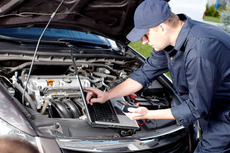 auto garage: Car mechanic working in auto repair service