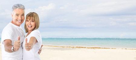 destination wedding: Happy senior couple on the beach