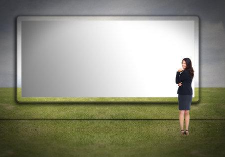 Business woman near billboard