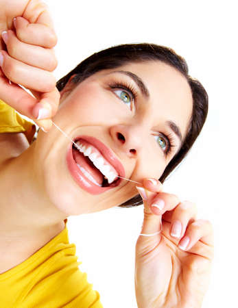 flossing: Beautiful woman with a dental floss  Stock Photo