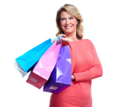 Senior woman with shopping bags  photo