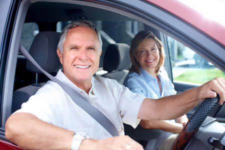 new motor vehicles: Happy senior couple in the car  Stock Photo