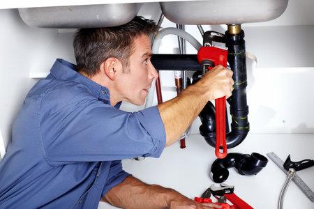 plumbing repair: Plumber  Stock Photo