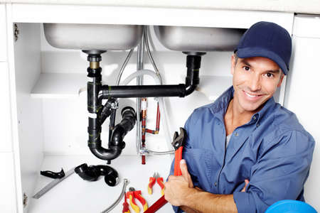 are working: Plumber  Stock Photo