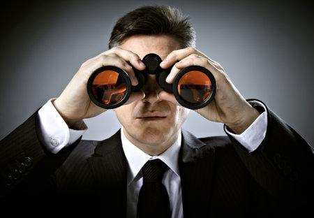 binocular: Businessman with binoculars