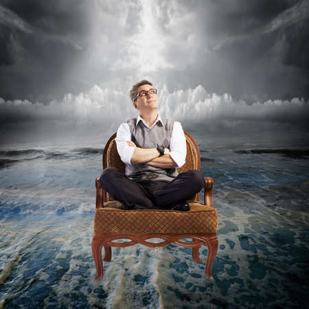 man in chair: Storm  Stock Photo