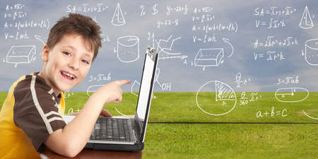 computer class: Young boy with laptop computer