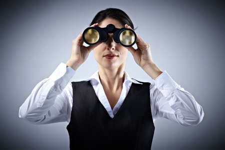 Business woman with binoculars  Stock Photo - 18763737