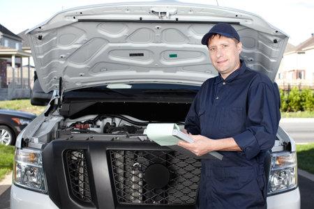 Car mechanic working in auto repair service Stock Photo - 18763752