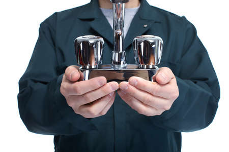 Hands of plumber with faucet  Stock Photo - 18767738