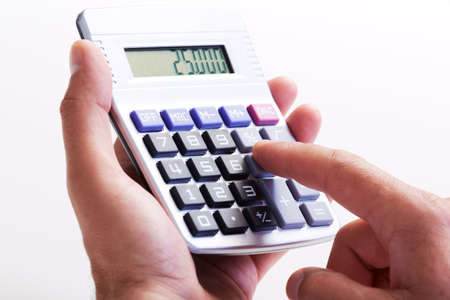 calculation: Hand with calculator