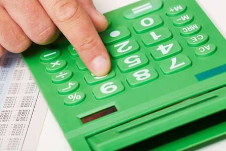 the bookkeeper: Hand with calculator