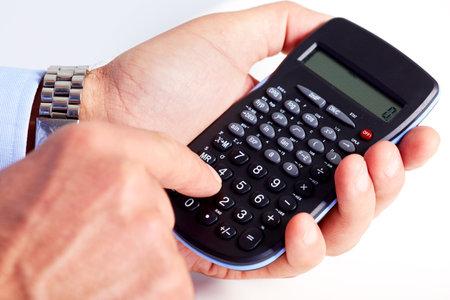 Hand with calculator  photo