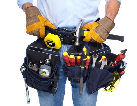 Travailleur avec une ceinture à outils Banque d'images