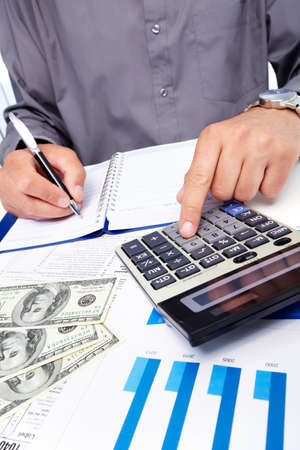 Hands of businessman with calculator  Stock Photo - 19354803
