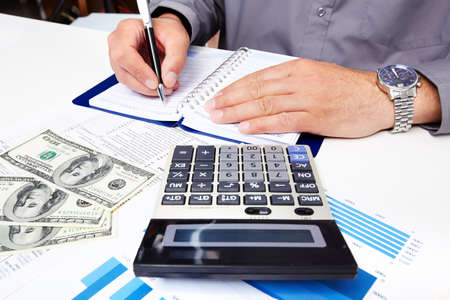 Hands of businessman with calculator  Stock Photo - 19354810