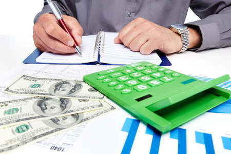 Hands of businessman with calculator Stock Photo - 19354789
