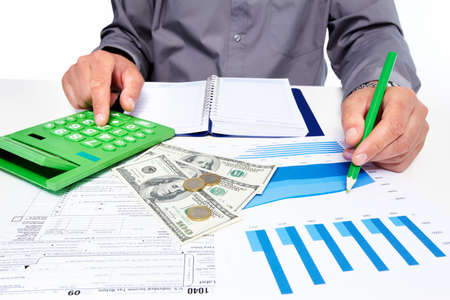 Hands of businessman with calculator Stock Photo - 19354790