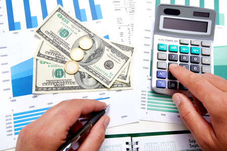 Hands of businessman with calculator Stock Photo - 19354813