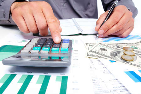 Hands of businessman with calculator  Stock Photo - 19354797