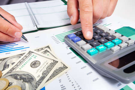Hands of businessman with calculator Stock Photo - 19354809