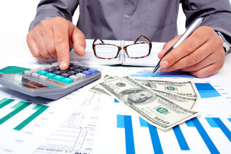 Hands of businessman with calculator Stock Photo - 19354796
