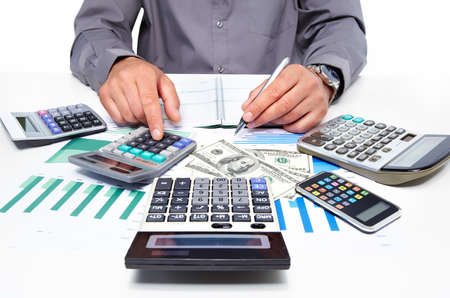 calculations: Hands of businessman with calculator