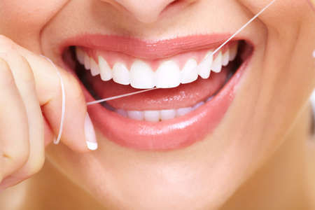 dental floss: Beautiful woman smile