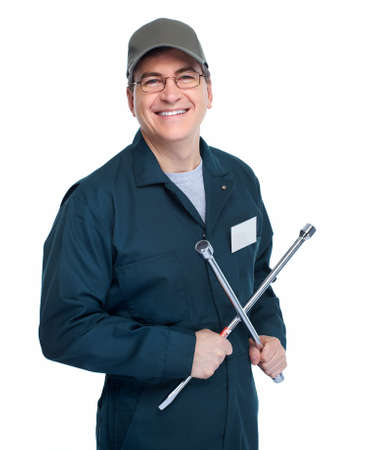 Auto mechanic with a wheel wrench  photo
