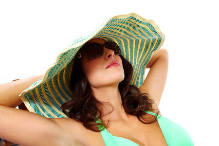 Woman wearing sunglasses and a hat  Stock Photo - 19989491