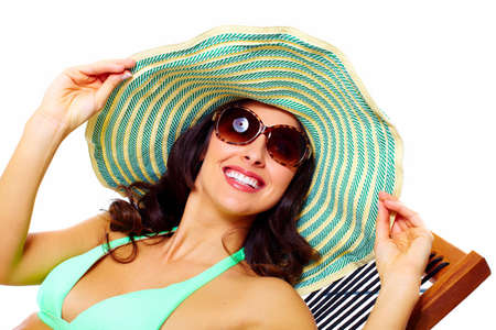Woman wearing sunglasses and a hat  Stock Photo - 19989494